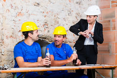 Lazy construction workers being in delay Stock Images