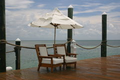 Lazy day. Chairs on dock Royalty Free Stock Photo