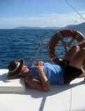 Lazy day on the water. Man having a lazy day on a yacht Royalty Free Stock Images