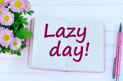 Lazy day words on notebook Royalty Free Stock Image