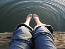 Lazy Days. Original image of feet being dipped in the river stock photos