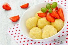 Lazy dumplings with cottage cheese and strawberries summer desse Stock Images
