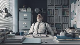 Lazy exhausted businessman napping in the office. Lazy exhausted businessman sitting at office desk and sleeping, he is snoring with his mouth open