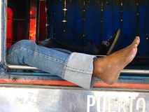 Lazy foot. Jeepney (bus) driver taking a nap: foot detail Royalty Free Stock Image