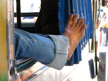 Lazy foot. Jeepney (bus) driver taking a nap: foot detail stock photos
