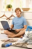 Lazy guy with computer Stock Photos