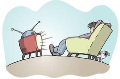Lazy guy watching tv Stock Photography