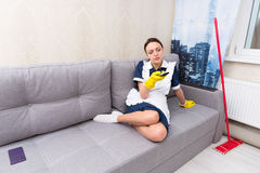 Lazy housekeeper taking a break Stock Photo