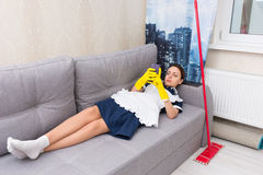 Lazy indolent maid or housekeeper Stock Photo