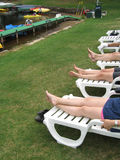 Lazy Legs by Lake. Four sets of Lazy Legs by Lake in Resort royalty free stock images