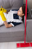 Lazy maid or housekeeper taking a break Stock Photos