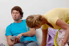 Lazy man and cleaning woman Stock Photography