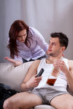 Lazy man drinking whiskey. Lazy men drinking whiskey and watching tv royalty free stock images
