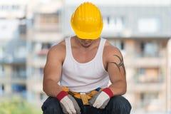 Lazy Man en la construcción Imagen de archivo libre de regalías