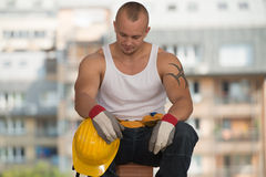 Lazy Man en la construcción Fotos de archivo