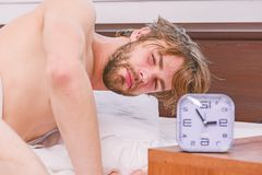 Lazy man happy waking up in the bed rising hands in the morning with fresh feeling relaxed. Feet of man sleeping in stock photo