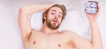 Lazy man happy waking up in the bed rising hands in the morning with fresh feeling relaxed. Man feeling back ache in the stock photos