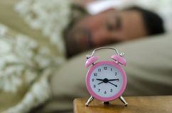 Lazy man lying in bed Royalty Free Stock Images