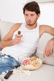 Lazy man with unhealthy treats Stock Photos
