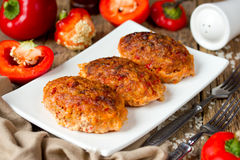 Lazy meat zrazy or cutlets with rice and red pepper Stock Photos