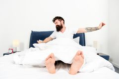 Lazy morning. energy and tiredness. Sleepy and handsome. asleep and awake. Too early to wake up. male with beard in. Pajama on bed. bearded man hipster sleep in stock photos