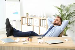Free Lazy Office Employee Procrastinating At Workplace Royalty Free Stock Photos - 178549488