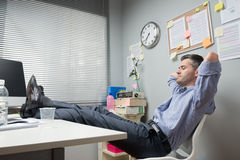 Lazy office worker feet up Royalty Free Stock Image