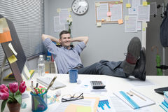 Lazy office worker feet up Stock Images