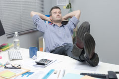 Lazy office worker feet up Stock Photos