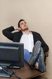 Lazy office worker resting feet on the desk Royalty Free Stock Photography