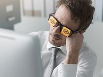 Free Lazy Office Worker Wearing Sticky Notes Over His Glasses Stock Photography - 149053672