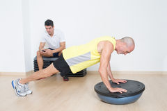 Lazy personal trainer Royalty Free Stock Image