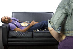 Lazy Roommate. Female angry at lazy male roommate making a mess Stock Photo
