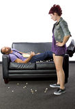 Lazy Roommate. Female angry at lazy male roommate making a mess Royalty Free Stock Image