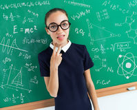 Lazy student with the examples on the blackboard. Photo of student in uniform, education concept stock photos