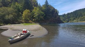 Kayaking on a lazy summer day on Oregon`s Rogue River. A nice paddle up from Orchard Hole on Oregon`s Wild and Scenic Rogue river east of Gold Beach on a lazy stock image