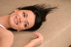Lazy Sunday morning. Close-up of beautiful young women lying on Royalty Free Stock Photos