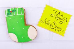 Lazy sweet New Year`s boot. Sweet food with New Year`s inscription. Inscription New Year and gingerbread stock photo