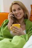 Lazy woman talking on the phone Royalty Free Stock Images