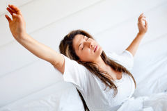Lazy woman yawning Stock Images