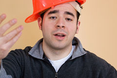 Lazy Worker. This young construction worker has his hard hat on sideways Royalty Free Stock Photos