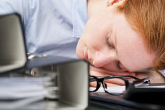 Lazy Worker Sleeping on Her Desk Royalty Free Stock Photo