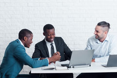 Lazy workers chatting in office. Bad discipline. royalty free stock images