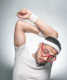 Lazy young man try to doing fitness royalty free stock photos