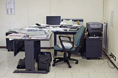 Lazybum. Lonely office room with messy desk filled up with documents Royalty Free Stock Images