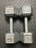 25 lb Barbells. A set of 25 LB iron barbells for working out at home or the gym Stock Image