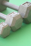 5, 10, and 15 lb hand weights in a row Stock Images