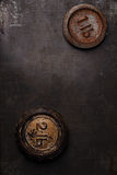 1 and 2 lb pound vintage iron weight on metal backdrop Royalty Free Stock Photos