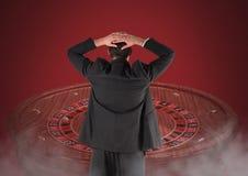 LBack des Mannes Roulette betrachtend Lizenzfreies Stockbild