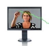 LCD监控妇女和图表 图库摄影